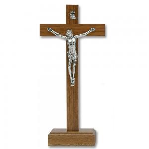 Croce in legno di noce chiaro con base e corpo di Cristo in metallo