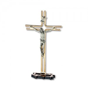 Golden metal cross with oxidized body and base