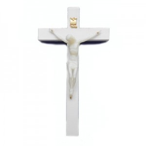 Crucifix in white plastic